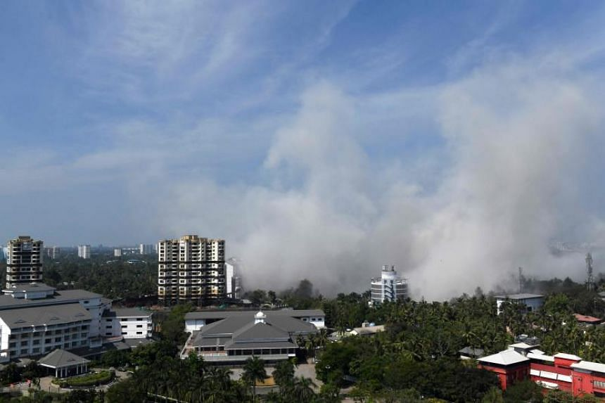 An apartment complex is pictured during a controlled implosion ordered by the Supreme Court for violating coastal construction regulations in Kochi, on Jan 11, 2020.