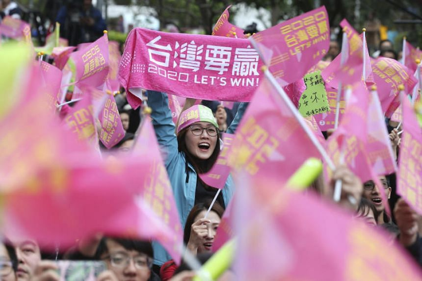 Supporters of Taiwan president Tsai Ing-wen cheer for Tsai's victory in the presidential elections in Taipei on Jan 11, 2020.