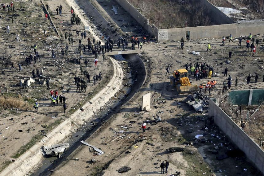 A photo taken on Jan 8, 2020, shows the scene where the Ukrainian plane crashed, in Shahedshahr, Iran. Iran's armed forces say they mistook the passenger plane for a cruise missile.
