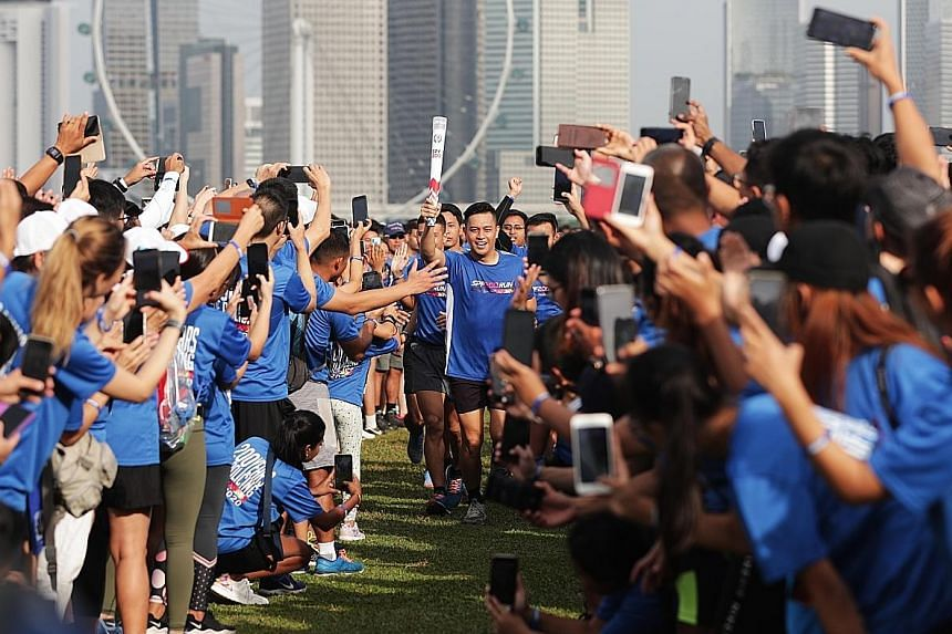 Runners at Marina Barrage yesterday during the SPF200 Run, the first in a series of events marking the Singapore Police Force's 200th anniversary.