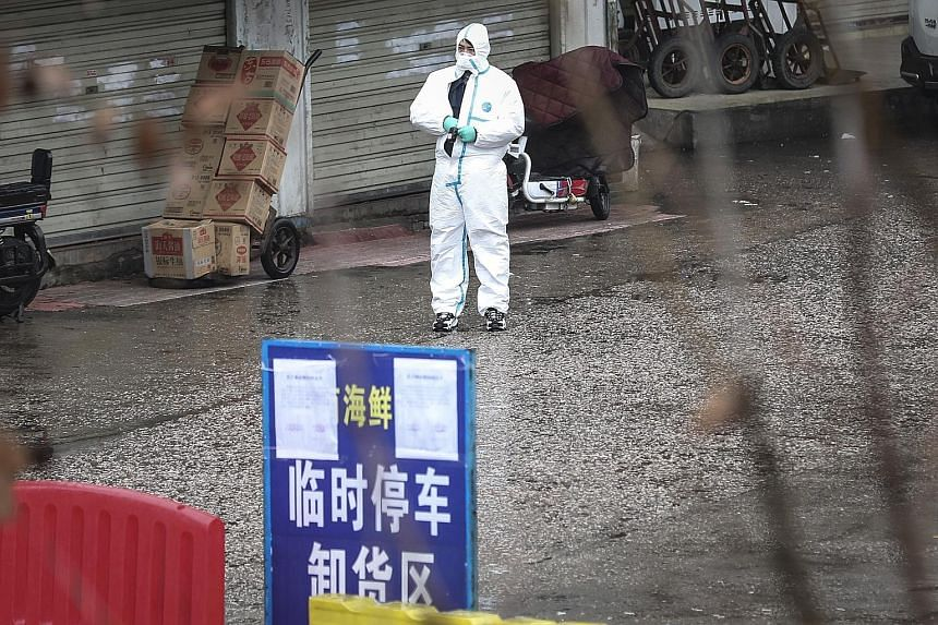 The inner courtyard of the Wuhan Huanan Seafood Wholesale Market, believed to be the centre of the mysterious pneumonia outbreak. The usually bustling market has been shuttered for disinfection since New Year's Day after workers at the site were affe