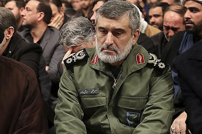 Above: General Amir Ali Hajizadeh, head of the Revolutionary Guards' aerospace division, at a mourning ceremony for Major-General Qassem Soleimani. Top: Rescuers at the scene of the Ukrainian passenger plane crash in Teheran.