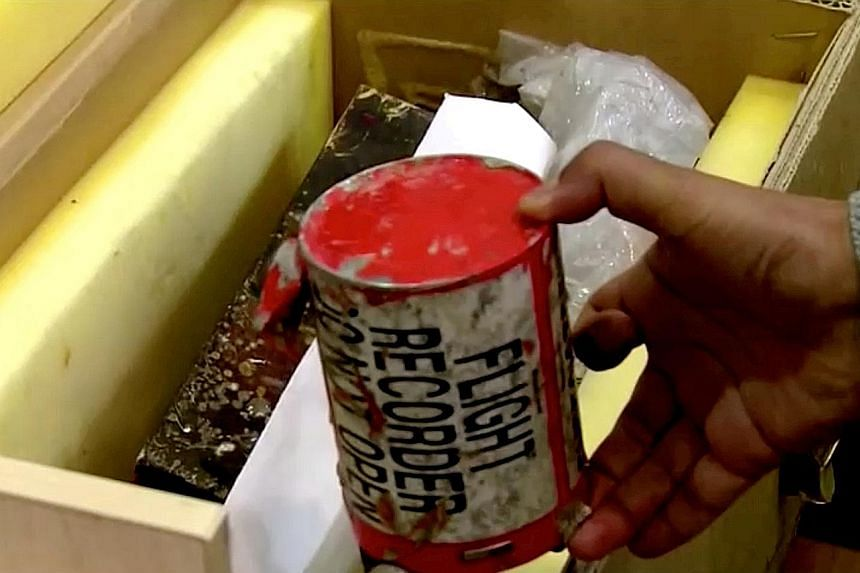 A flight recorder, also known as a black box, said to have been recovered from the crashed Ukrainian plane, as seen in an image taken from a video. PHOTO: REUTERS