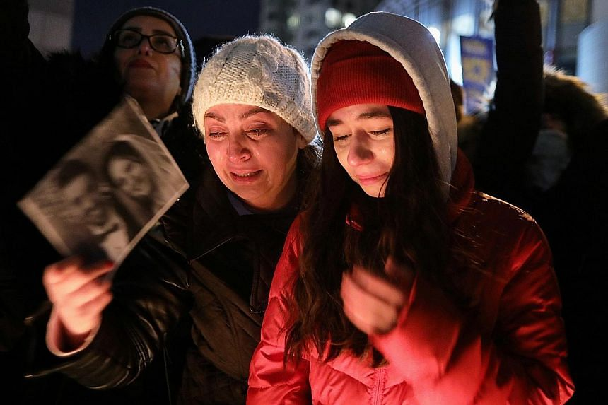Mourners attending an outdoor vigil for the victims of the doomed flight on Thursday. PHOTO: REUTERS