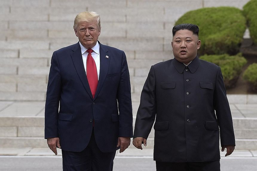 A file photo taken on June 30 last year showing US President Donald Trump with North Korean leader Kim Jong Un on the North Korean side of the border at the village of Panmunjom in the Demilitarised Zone.