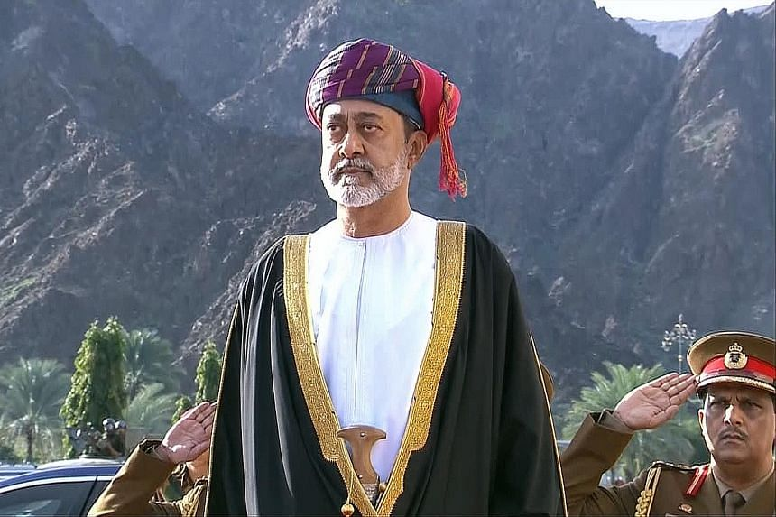 Oman's Sultan Haitham (left) was sworn in as the country's new leader yesterday following the death of his cousin Sultan Qaboos bin Said (above), seen as the father of modern Oman. PHOTOS: AGENCE FRANCE-PRESSE, ASSOCIATED PRESS