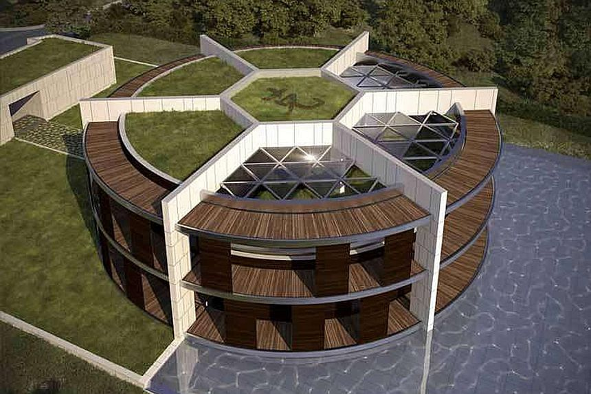 Footballer Lionel Messi's football-shaped house, designed by architect Luis de Garrido. Far from the nightlife of Sitges 20 minutes up the road, Messi ferries his sons to and from school and leads a private life. Former football star David Beckham's