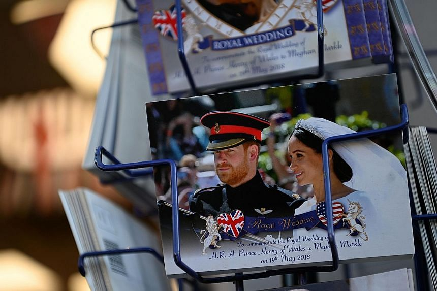 Memorabilia featuring Britain's Prince Harry and his wife Meghan in a store near Buckingham Palace in London. Senior royals were caught off guard by the couple's Wednesday announcement that they were quitting their front-line royal duties.