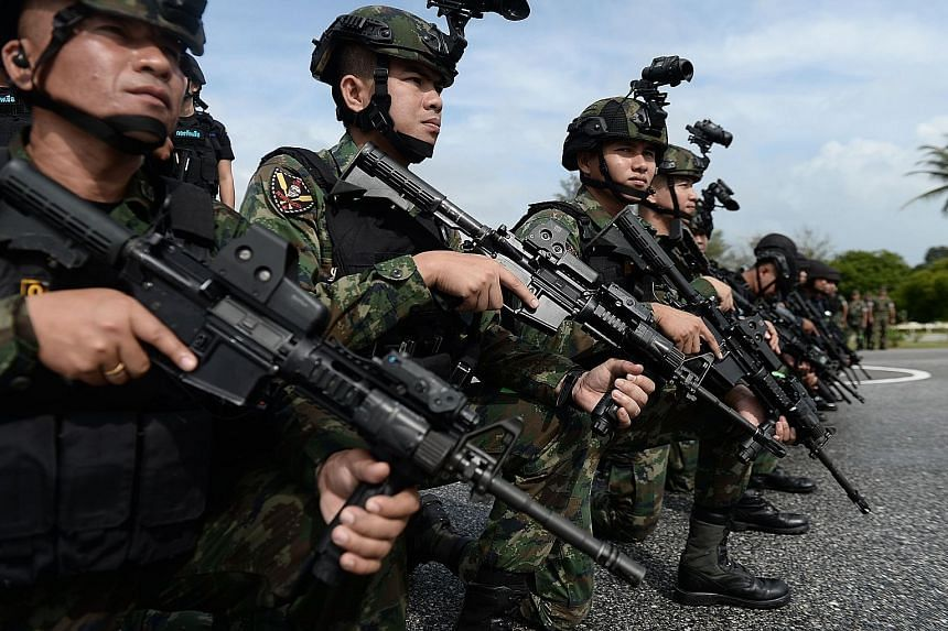 Royal Thai Marines gathering in formation during a ceremony in Chulabhorn Camp in November. The 124.4 billion baht defence budget was among the main topics during Thailand's budget debate.