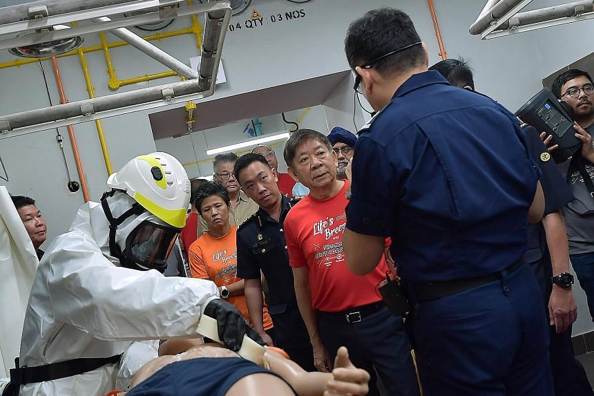 Left: The civil defence shelter has hardened boundary walls, and floor and roof slabs built from reinforced concrete. Above: Transport Minister Khaw Boon Wan at the decontamination chamber of the Woodlands MRT station civil defence shelter yesterday.