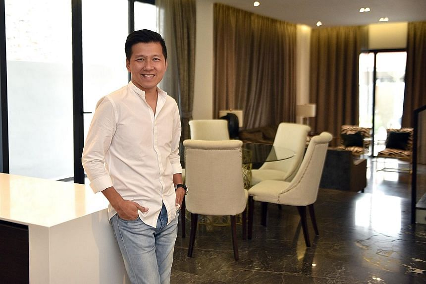 Mr Toh's favourite part of his home is the living room, with its full marble flooring and a customised full-length glass panel.