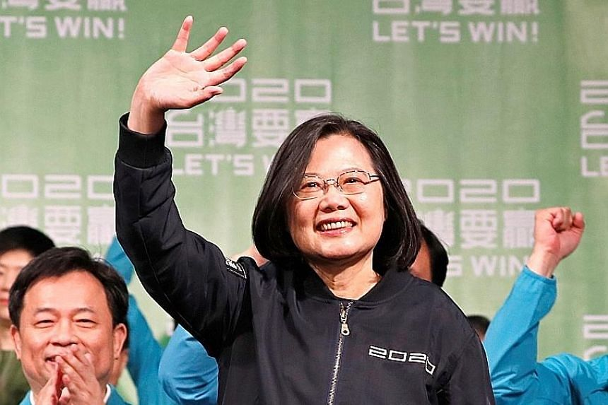 Taiwan's President Tsai Ing-wen, who won 57 per cent of the votes, acknowledging supporters outside the Democratic Progressive Party headquarters in Taipei after her victory yesterday. ▕