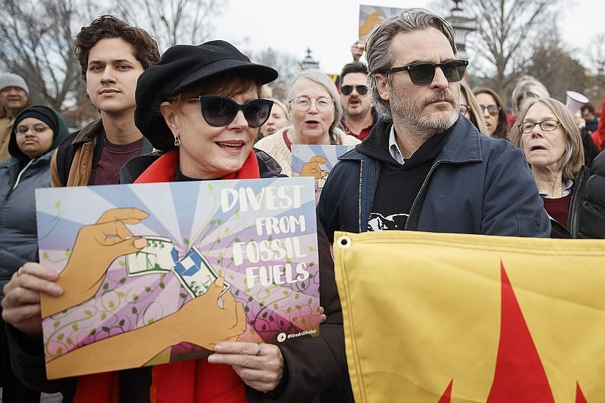 Susan Sarandon and Joaquin Phoenix taking part in a march with protesters against climate change at the US Capitol on Friday. Other Hollywood celebrities who joined the protesters included Jane Fonda and Martin Sheen.