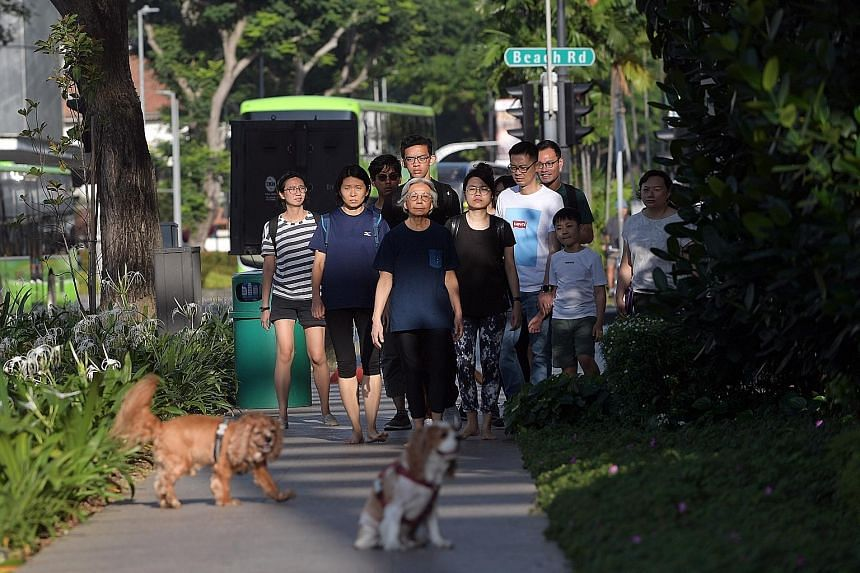 Artist Amanda Heng, with fellow performers behind her, doing a reprise of her classic performance art piece Let's Walk as part of the Singapore Biennale. Ms Heng, whose works explore social and cultural issues, said last night that receiving the Bene