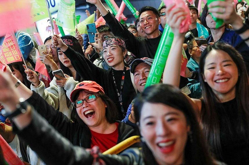 Supporters of Taiwan President Tsai Ing-wen during a rally outside the Democratic Progressive Party headquarters in Taipei yesterday. Many Hong Kongers had also travelled to Taiwan and attended Ms Tsai's rallies.