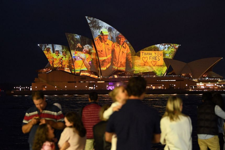 The sails of the Sydney Opera House are lit with a series of images to show support for the communities affected by the bush fires and to express the gratitude to the emergency services and volunteers, on Jan 11, 2020.