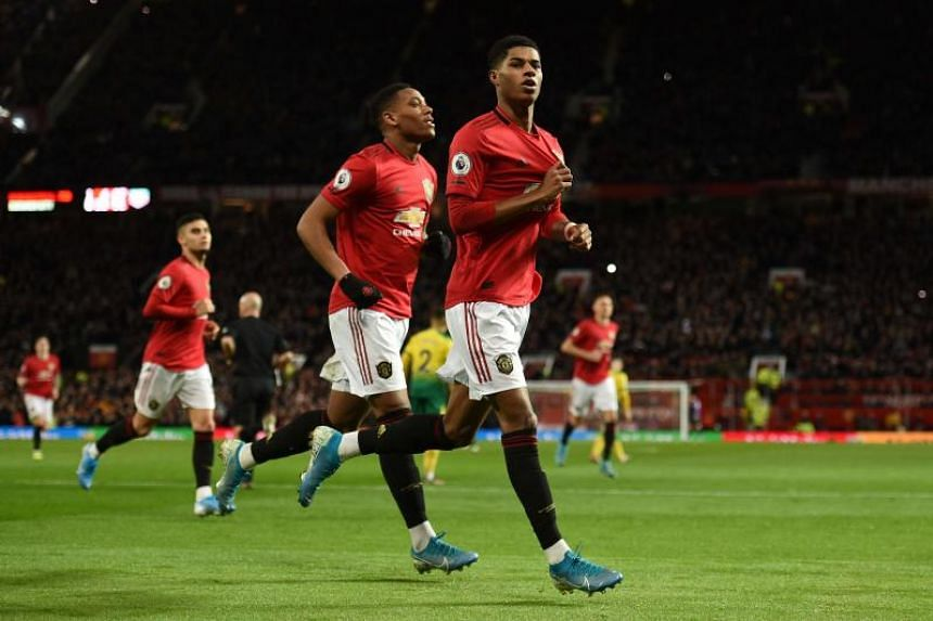 Manchester United striker Marcus Rashford (right) celebrates scoring their second goal during the English Premier League football match against Norwich City at Old Trafford on Jan 11, 2020.