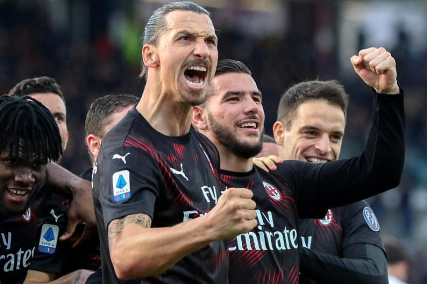 Milan's Zlatan Ibrahimovic (centre) celebrates with teammates after scoring during the Italian Serie A football match between Cagliari Calcio and AC Milan in Italy,on Jan 11, 2020.