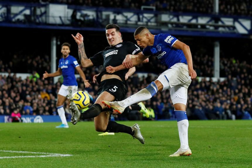 Everton's Richarlison shoots at goal as Brighton & Hove Albion's Lewis Dunk attempts to block during their English Premier League match on Jan 11, 2020.