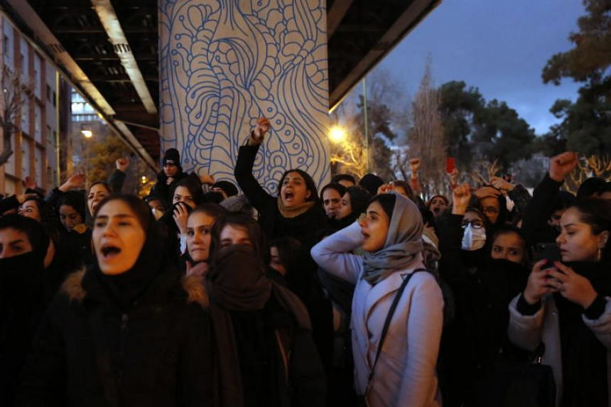 Iranians protest to show their sympathy to victims of Ukraine International Airlines Boeing 737-800 in front of the Amir Kabir University in Teheran, on Jan 11, 2020.