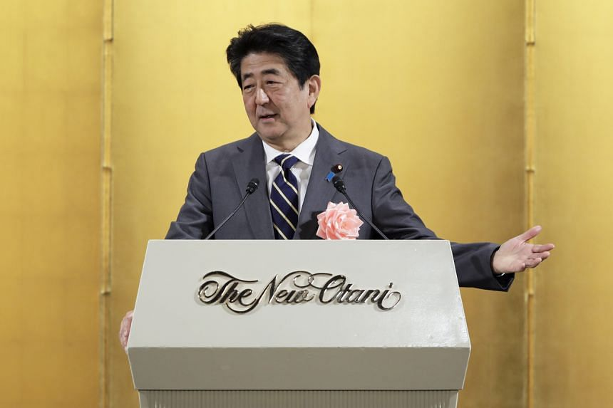 Japan's prime minister Shinzo Abe gestures while speaking during a New Years gathering for business leaders in Tokyo on Jan 7, 2020.