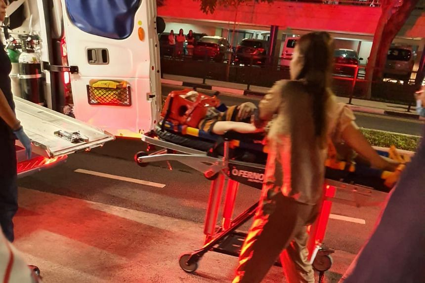 The victim being escorted onto an ambulance after her fall on Jan 11, 2020.
