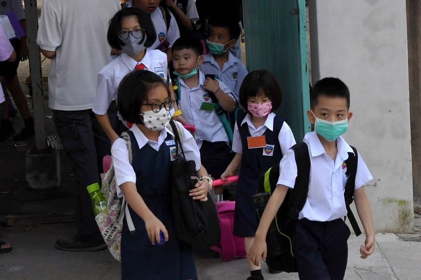 Students at a Chinese language school in Penang, where some students were also hit by flu, wearing face masks on Jan 9, 2020. Johor Baru has 56 cases which is the highest number in Johor state.