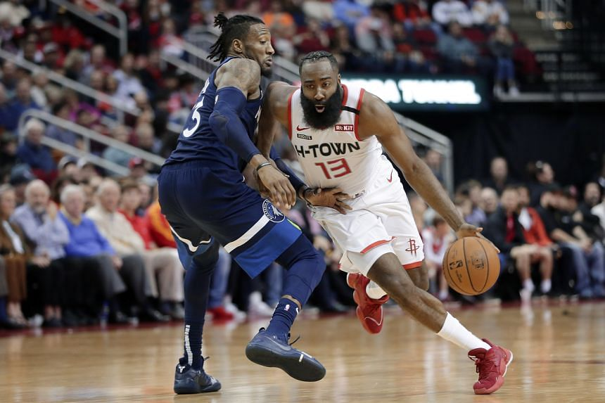 Houston Rockets guard James Harden (13) drives around Minnesota Timberwolves forward Robert Covington, during the second half of an NBA basketball game on Jan 11, 2020.