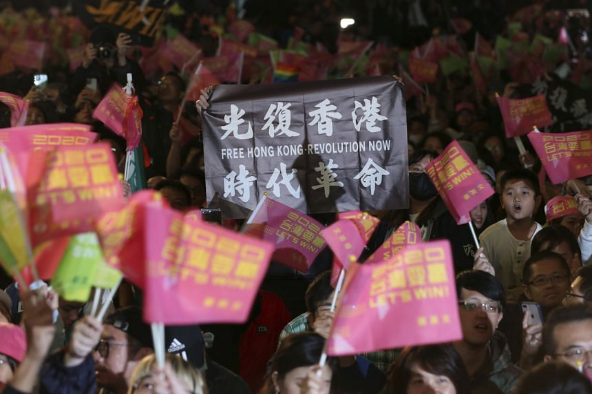 Hong Kong supporters of Taiwan's 2020 presidential election candidate, Ms Tsai Ing-wen, hold slogans as they gather to watch the election results on Jan 11, 2020.