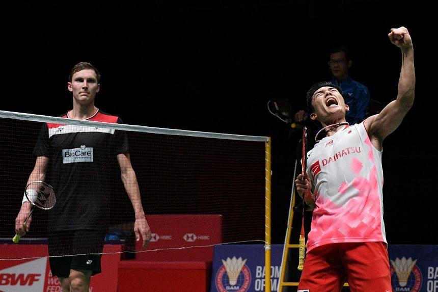 Japan's Kento Momota (right) celebrates after winning against Denmark's Viktor Axelsen at the Malaysia Open badminton tournament in Kuala Lumpur on Jan 12, 2020.
