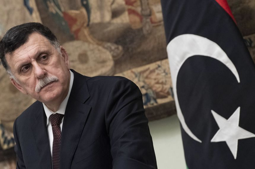 Libya's prime minister of the Government of National Accord of Libya, Fayez al-Sarraj speaks during a press conference in Rome, on Jan 11, 2020.