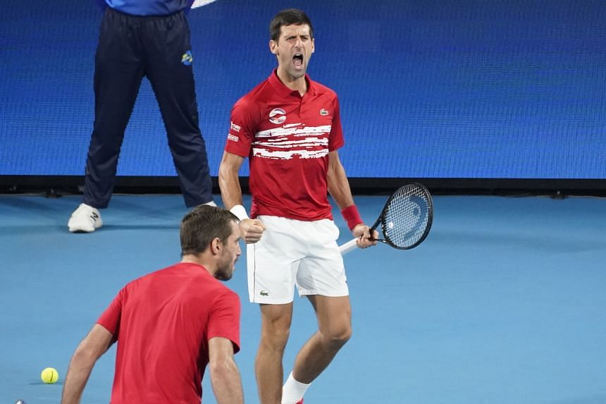 Novak Djokovic (right) and Viktor Troicki celebrate winning the ATP Cup tennis tournament at the Ken Rosewall Arena on Jan 12, 2020.