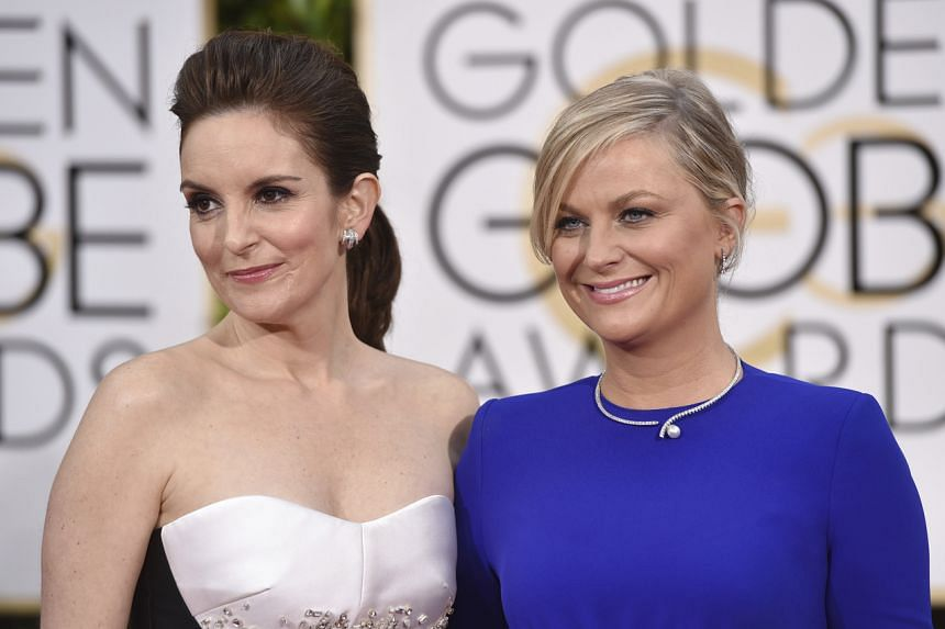 In a photo taken on Jan 11, 2015, Tina Fey (left) and Amy Poehler arrive for the 72nd annual Golden Globe Awards in Beverly Hills.