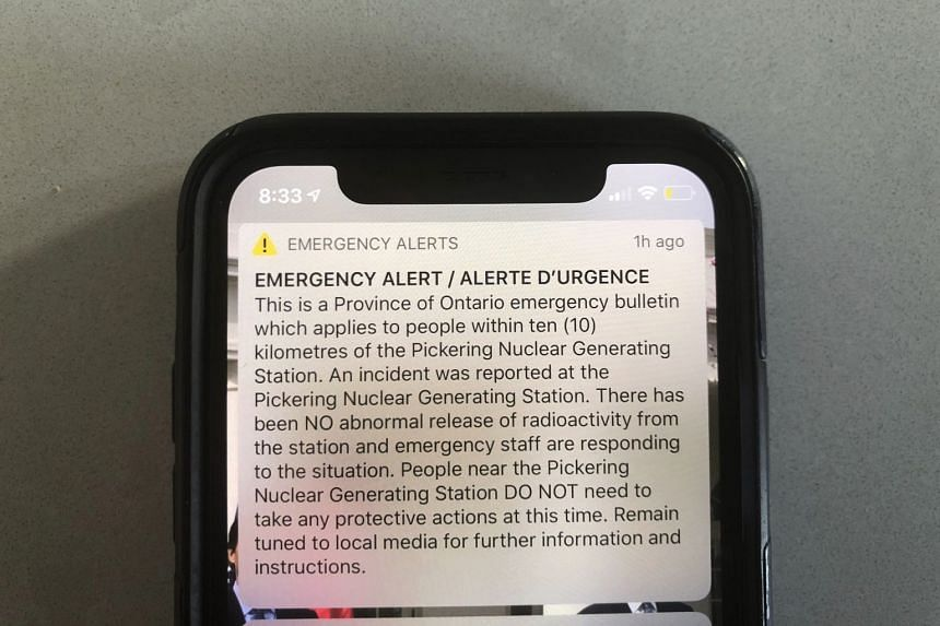 An emergency alert issued by the Canadian province of Ontario is shown on a smartphone.