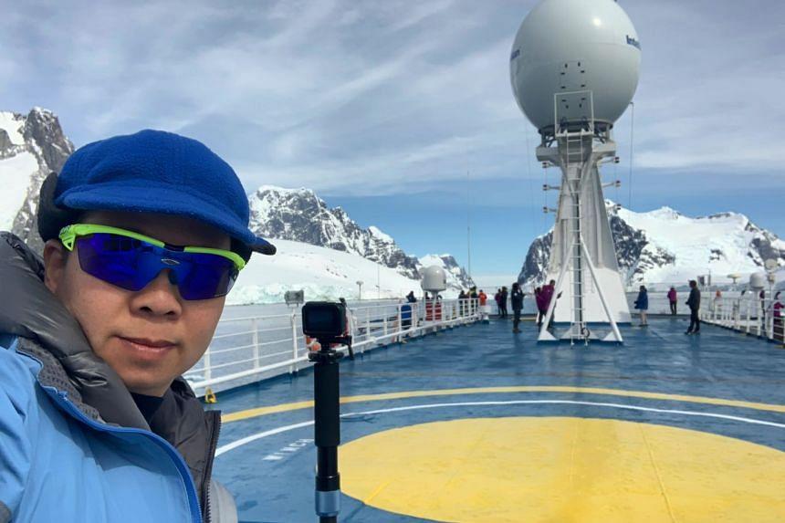 Photographer Ashleigh Sim on the deck of the Ocean Atlantic.