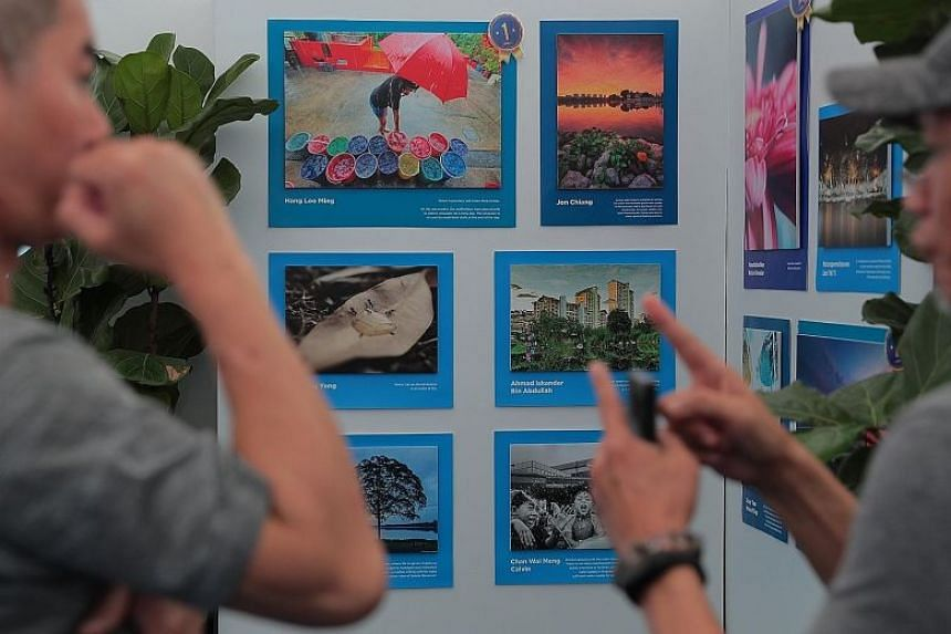 Photos submitted for national water agency PUB's #MyTakeOnWater photo challenge on display at Ngee Ann City on Jan 12, 2020.