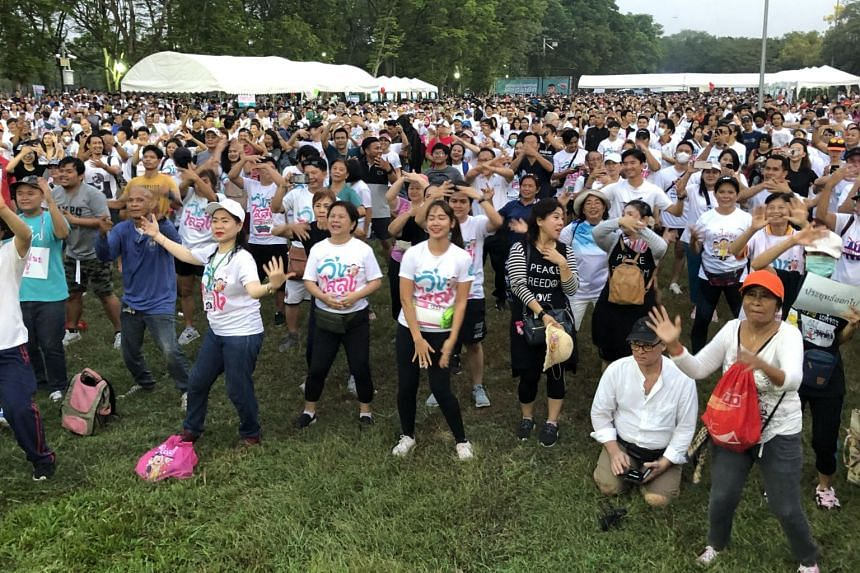 Attendees of the Run Against Dictatorship event warming up in Bangkok, on Jan 12, 2020.