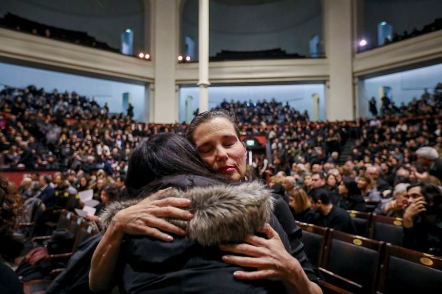Canadian MP Kirsty Duncan consoles a woman at the memorial in Toronto on Jan 12, 2020.