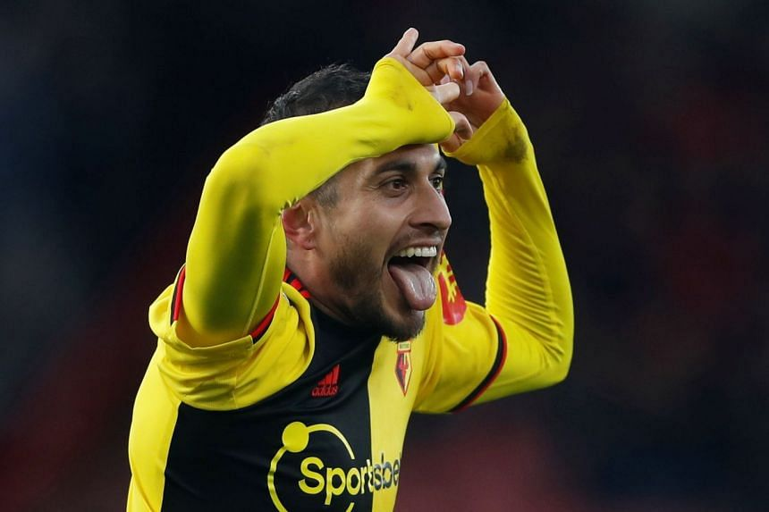 Watford's Roberto Pereyra celebrates scoring their third goal.