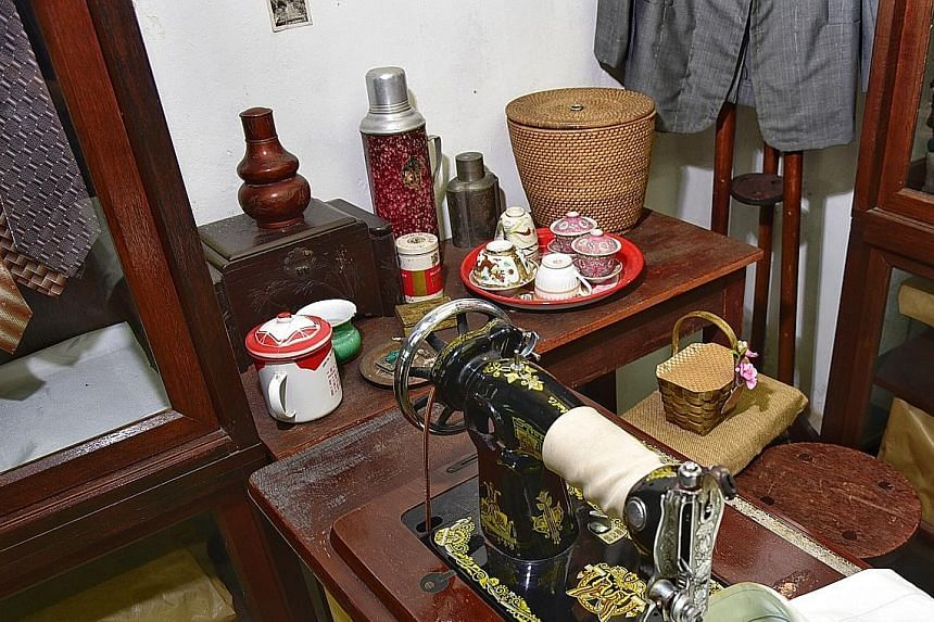 During the Festive Mouse Hunt, visitors can look for tiny, handmade baskets, such as this one behind the sewing machine. Each basket contains an ink stamp with a design inspired by Chinatown's history.