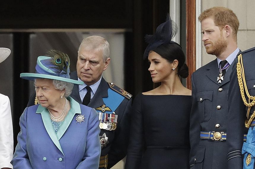 A 2018 file photo of Britain's Queen Elizabeth II with her son Prince Andrew, grandson Prince Harry and his wife Meghan on the balcony of Buckingham Palace in London.