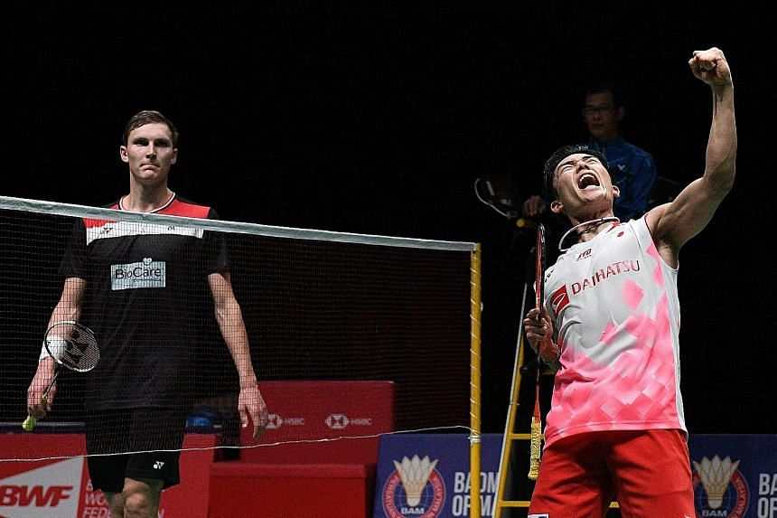 Kento Momota punching the air after sealing victory in the Malaysia Masters final against a despondent Viktor Axelsen. The Japanese world No. 1's win in Kuala Lumpur was the 13th straight time he had beaten the Dane, dating back to 2014.