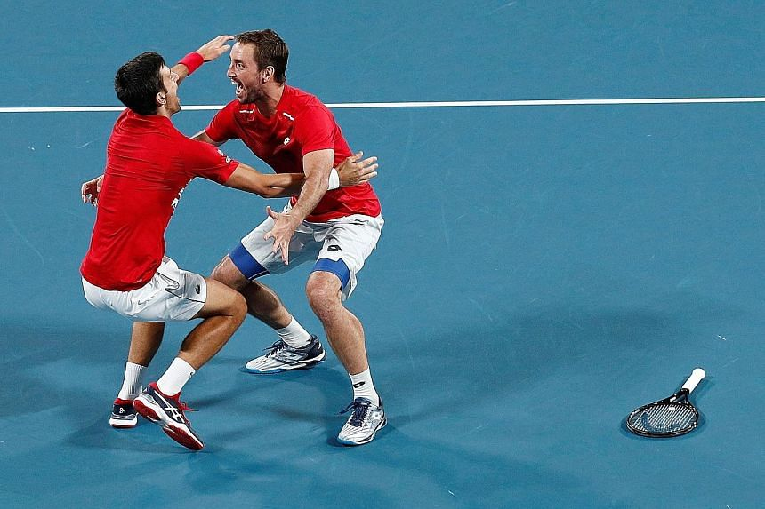 Novak Djokovic and Viktor Troicki celebrating Serbia's ATP Cup victory after winning their doubles match against Spain's Pablo Carreno Busta and Feliciano Lopez. Djokovic did not lose a match in the tournament, earning six singles and two doubles win