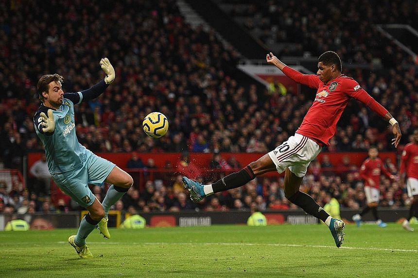 Manchester United striker Marcus Rashford scoring the opener against Norwich's Tim Krul on Saturday. In his 200th game for United, the 22-year-old added a second from the spot to reach 19 goals this season.