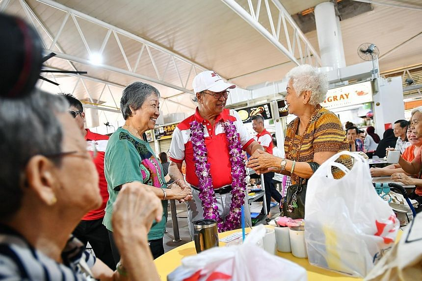 Dr Tan Cheng Bock of the Progress Singapore Party greeting West Coast GRC residents at the food centre in Teban Gardens Road yesterday, the same day his party made its first door-to-door visits to homes in the area.