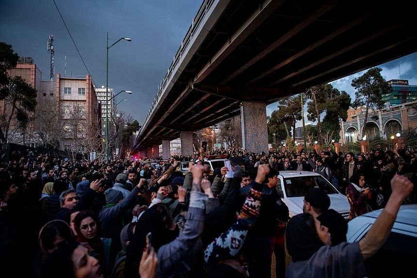 """Demonstrators chanting during a vigil in Teheran last Saturday for the victims of the downed Ukraine International Airlines plane. After three days of denials, Teheran admitted early last Saturday that it had """"unintentionally"""" shot down the jet after"""