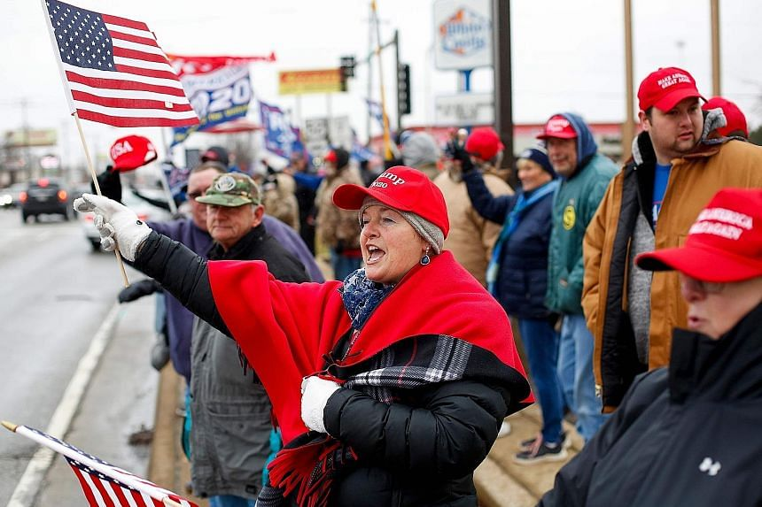 Demonstrators at a pro-Trump rally in the US state of Illinois on Saturday. The current trade truce could help President Donald Trump on the campaign trail by giving the American economy a boost. A worker packing bottles of oil made from imported US