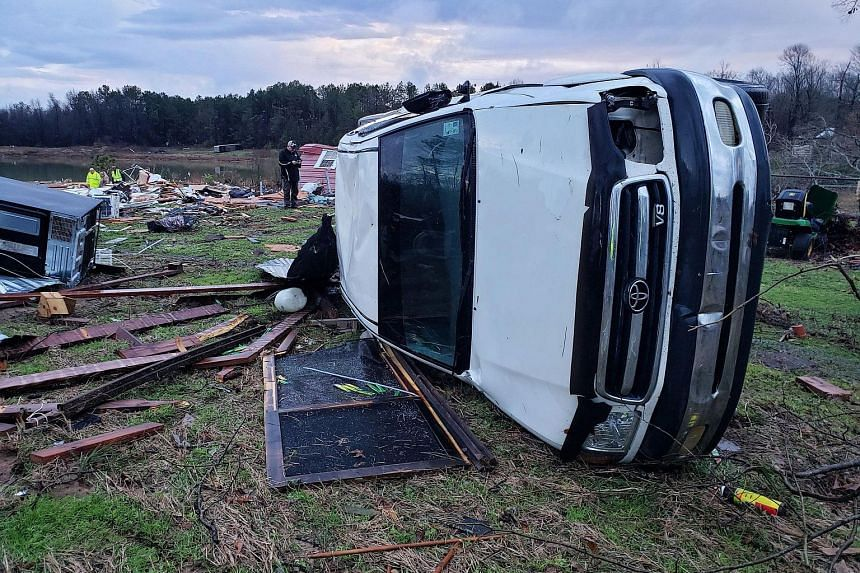 A large vehicle flipped on its side in Bossier Parish, Louisiana, after a tornado with winds of around 217kmh hit the area last Saturday. Severe storms sweeping in the US have killed at least 11 people as high winds, tornadoes and rain battered the c