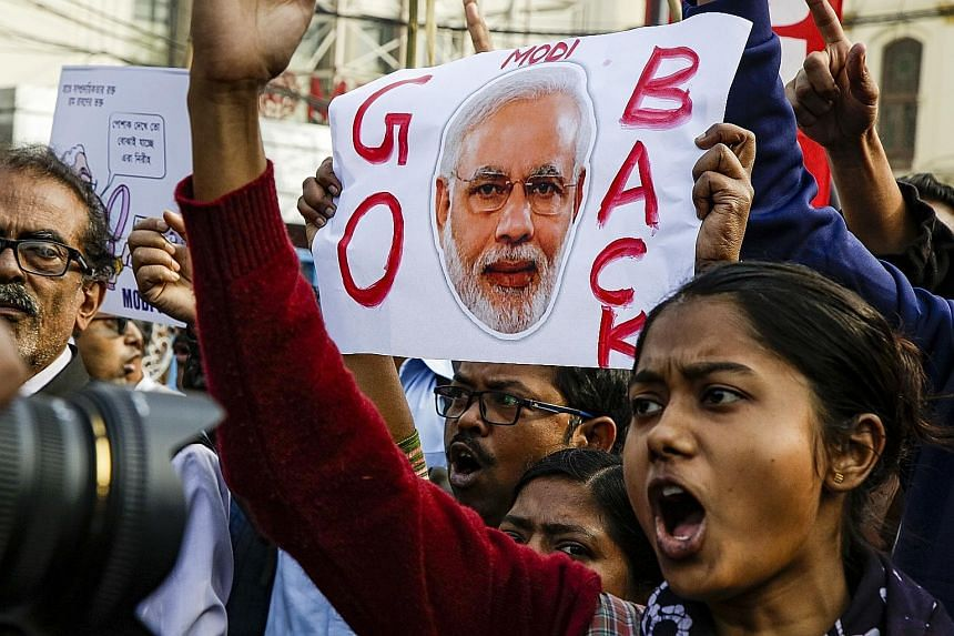 University students protesting against India's new citizenship law and the visit of Prime Minister Narendra Modi to Kolkata last Saturday. The controversial law offers citizenship to non-Muslim illegal migrants from three neighbouring countries - Afg