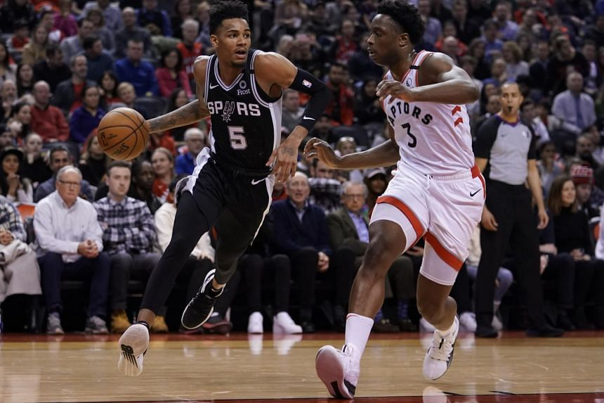 San Antonio Spurs guard Dejounte Murray (left) drives to the net against Toronto Raptors forward OG Anunoby in Toronto on Jan 12, 2020.